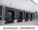 warehouse dock truck doors ... | Shutterstock . vector #1404583259