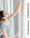 young woman taking measurements ... | Shutterstock . vector #1404603146
