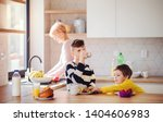 a young woman with two children ... | Shutterstock . vector #1404606983