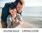 father with small son on a walk ... | Shutterstock . vector #1404611036