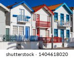 street with colorful houses in... | Shutterstock . vector #1404618020