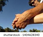 male hand holding female hand ... | Shutterstock . vector #1404628340