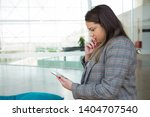 pensive business woman using... | Shutterstock . vector #1404707540