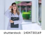 portrait of young asian doctor... | Shutterstock . vector #1404730169
