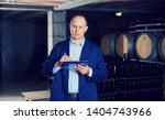 confident male winemaker... | Shutterstock . vector #1404743966