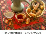 an arabic coffee pot and dates... | Shutterstock . vector #140479306