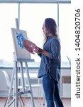 side view of inspired female... | Shutterstock . vector #1404820706
