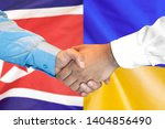 business handshake on the... | Shutterstock . vector #1404856490