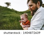father walking with infant baby ... | Shutterstock . vector #1404872639