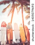 surfboard and palm tree on... | Shutterstock . vector #1405079693