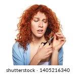 beautiful young woman cutting... | Shutterstock . vector #1405216340