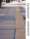 bright yellow tactile footpath... | Shutterstock . vector #1405258193