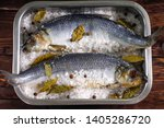 Stock photo salted herring in sea salt with spices in containers on wooden background dry salting 1405286720