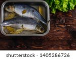 Stock photo salted herring in brine in a container on a wooden background 1405286726