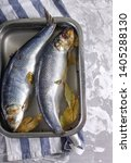 Stock photo salted herring in brine in container on a concrete background 1405288130