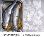 Stock photo salted herring in brine in container on a concrete background 1405288133