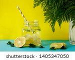 lemonade with fresh lemon.... | Shutterstock . vector #1405347050