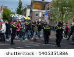 police controlling crowd at... | Shutterstock . vector #1405351886