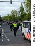 police controlling crowd at... | Shutterstock . vector #1405351910