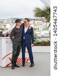 """Small photo of CANNES, FRANCE - MAY 22, 2019: Brad Pitt and Leonardo DiCaprio attend thephotocall for """"Once Upon A Time In Hollywood"""" during the 72nd annual Cannes Film Festival"""