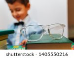 glasses on a stack of books ... | Shutterstock . vector #1405550216