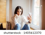 happy woman in t shirt sitting... | Shutterstock . vector #1405612370