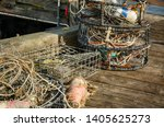 Crab Pots Stacked On Wooden Dock
