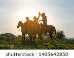 cowboys on horseback.cowboys... | Shutterstock . vector #1405642850