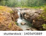 beautiful forest waterfall at... | Shutterstock . vector #1405693889