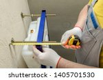 a worker is measuring the... | Shutterstock . vector #1405701530