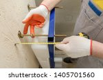 a worker is measuring the... | Shutterstock . vector #1405701560