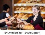 friendly saleswoman in bakery... | Shutterstock . vector #140605894