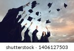A Group Of Graduates Throws...