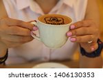 girl hands holding a cup of... | Shutterstock . vector #1406130353