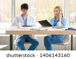 male doctor and female medical... | Shutterstock . vector #1406143160