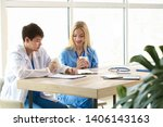 male doctor and female medical... | Shutterstock . vector #1406143163