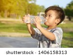 the boy raised a bottle of... | Shutterstock . vector #1406158313