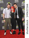 Small photo of LOS ANGELES, CA - APRIL 14, 2013: Musicians Jeremy Davis, Hayley Williams & Taylor York of Paramore at the 2013 MTV Movie Awards at Sony Studios, Culver City.