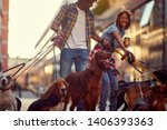 Stock photo group of dogs with dog walkers and leash ready to go for a walk outdoors 1406393363