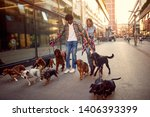 Stock photo happy dog girl and man walks dogs and enjoying outdoors 1406393399