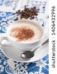 cappuccino on rustic blue tile | Shutterstock . vector #1406432996