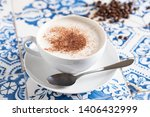 cappuccino on rustic blue tile | Shutterstock . vector #1406432999