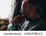Stock photo a portrait of a charismatic wise and talented artist who sits in his small studio filled with 1406458613