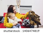 Stock photo the owl sits on the girl s hand the woman with the owl 1406474819
