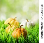 Pumpkins In Green Grass On...
