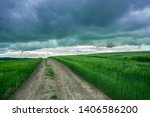 Country Road Through A Field O...