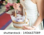 Woman In White Dress Holding A...
