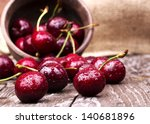 Cherries On Wooden Table With...