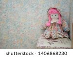 Vintage Doll On A Flowers Wall...