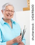 active old lady with paintbrush ... | Shutterstock . vector #140698600
